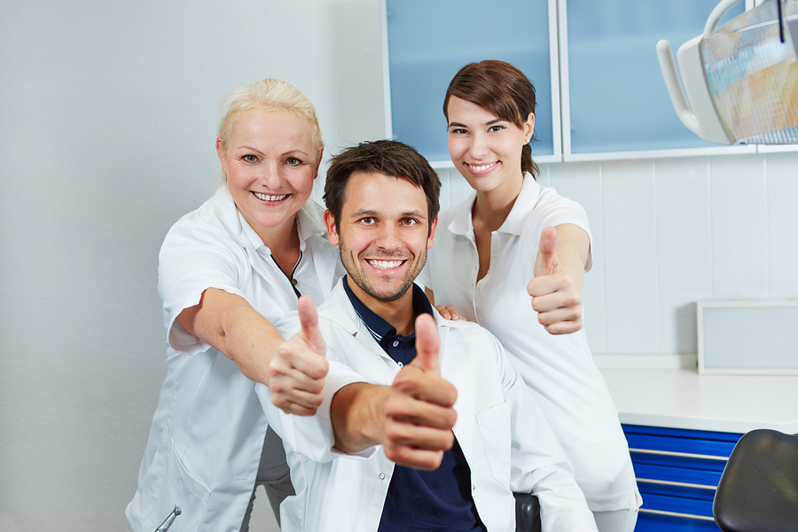 bigstock Happy dentist and smiling dent 50885639